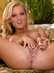 Melissa XoXo stimulates her pussy with a dildo