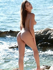Cute euro babe Adriana naked on the rocks by the blue sea