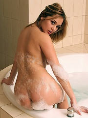 Lenka playing in her hot bubble bath