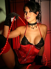 A horny babe in red corset masturbating